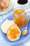 Sweet bun with apricot jam on plate and coffee for breakfast Royalty Free Stock Photography