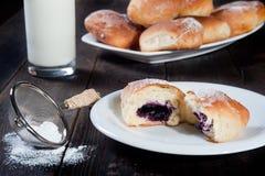 Sweet bun with blueberries jam Royalty Free Stock Photo