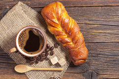 Sweet bun and coffee Stock Images