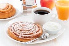 Sweet bun, cream, orange juice and coffee Stock Images