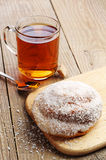 Sweet bun and cup of tea Royalty Free Stock Image