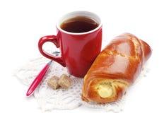 Sweet bun and cup of tea Stock Photos
