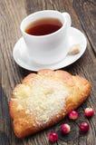 Sweet bun with cup of tea Stock Photo