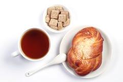 Sweet bun and cup of tea Stock Photography