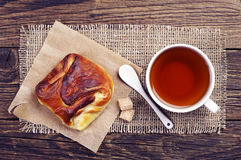 Sweet bun and cup of tea Royalty Free Stock Photo