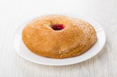 Sweet bun with jam in white plate on table Royalty Free Stock Photos