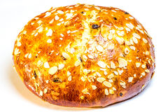 Sweet bun. Loaf of sweet bread topped with rolled almonds Stock Photo