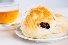 Sweet bun with raisin for tea break Royalty Free Stock Image