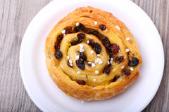 Sweet bun with raisins and cream Stock Photos