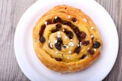 Sweet bun with raisins and cream Stock Photos