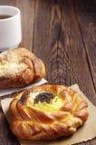 Sweet bun and tea Stock Image