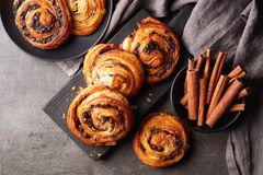 Sweet buns on black board isolated on stone table, from above royalty free stock images