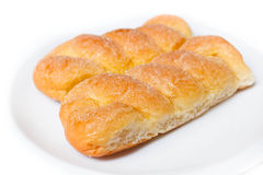 Sweet buns with butter and sugar. Royalty Free Stock Photo