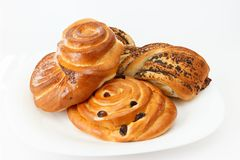 Sweet buns with cinnamon and raisins. Royalty Free Stock Photography