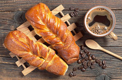 Sweet buns and coffee Stock Images