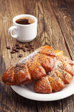 Sweet buns and cup of coffee Royalty Free Stock Photo