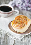 Sweet buns and cup of coffee Stock Photos