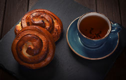 Sweet buns with cup of tea Stock Photo