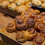 Sweet buns on cutting board. Royalty Free Stock Photos