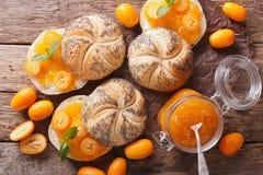Sweet buns with kumquat jam and cream cheese close-up. horizonta Royalty Free Stock Image