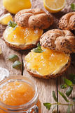 Sweet buns with lemon marmalade and butter macro. vertical Stock Images