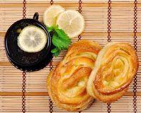 Sweet buns, lemon and tea Royalty Free Stock Photography