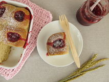 Sweet buns with lingonberry jam and powdered sugar Royalty Free Stock Image