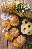 Sweet buns with pineapple jam and cream cheese close-up. vertica Stock Photos