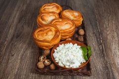 Sweet buns and plate of cottage cheese Stock Photo