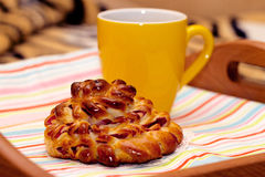 Sweet buns and tea for breakfast. Beautiful curled shape Royalty Free Stock Image