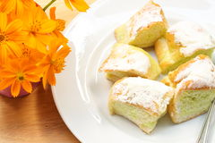 Sweet butter bread on the wooden table and flower. Stock Photo