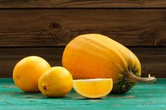 Sweet butternut squash, orange and lemon on wooden turquoise tab Stock Images