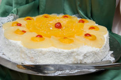 Sweet cake. Picture of a sweet cake with fruits and cream Stock Images