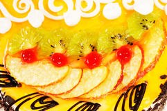 Sweet cake background. Sweet cake with sugared fruit close-up for background stock photo