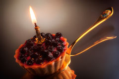 Sweet cake with candle on grey Royalty Free Stock Images