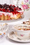 Sweet cake with cherry jelly, tasty and fresh. Antique tea set stock photography