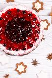 Sweet cake with cherry jelly, tasty and fresh on a white shabby wooden table royalty free stock photo
