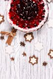 Sweet cake with cherry jelly, tasty and fresh on a white shabby wooden table stock photos