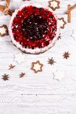 Sweet cake with cherry jelly, tasty and fresh on a white shabby wooden table stock images