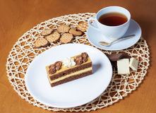 Sweet cake with cup of tea, cookies  and chocolate Stock Image