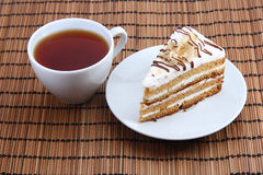 Sweet cake with cup of tea. On the Mat Royalty Free Stock Images