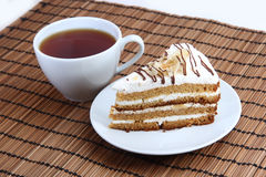 Sweet cake with cup of tea. On the Mat Stock Photo