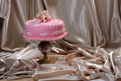 Sweet cake decorated with fondant on a cake stand. Sweet cake decorated with fondant, on the plate royalty free stock photography