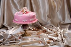 Sweet cake decorated with fondant on a cake stand. Sweet cake decorated with fondant on the plate stock photography