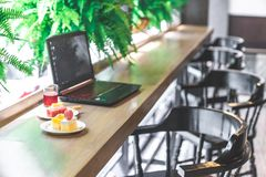 Sweet cake on desk with laptop in background, copy space. Sweet cakes and drink on desk with laptop in background, copy space royalty free stock images