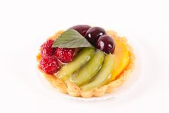 Sweet cake with fruits isolated on white.  Royalty Free Stock Images