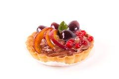 Sweet cake with fruits isolated on white.  Stock Photo