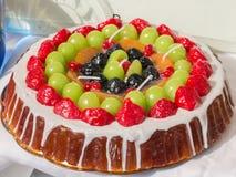 Sweet cake imitation: colorful wax mix fruits candles tart Royalty Free Stock Photo