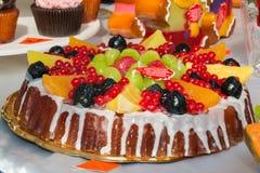 Sweet cake imitation: colorful wax mix fruits candles tart Royalty Free Stock Photography