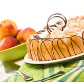 Sweet cake and peachs Stock Photography